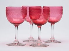 A fine set four antique wine glasses on clear stems with cranberry glass bowls with finely detailed wheel cut engraving. These quality glasses are not marked. This item has been fully inspected in house. Cranberry Wine, Wine Glass, Alcoholic Drinks, Glasses, Antiques, Glass Bowls, Tableware, Stems, House