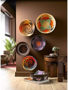 Swazi bowls - a great way to display them. Great colours that go well with the brown walls