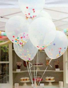 Clear balloons with confetti.