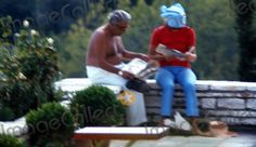 """Ari and Jackie reading on the """"back porch"""" of """"Jackie's Villa."""" (picturecollect)"""