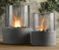 For some warm firey glow right on your table, try these Fire Columns, made of concrete and glass. They include river rocks and a stainless steel snuffer. Only to be used with Real Flame Disposable Gel Fuel Single-Use Can. | HellaWella
