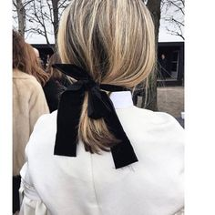 simple low ponytail with black ribbon.