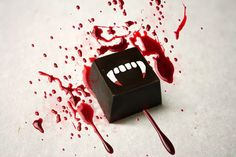Heavenly organic gourmet chocolate truffles filled with an infusion of blood orange puree and Compartes signature smooth chocolate ganache, adorned with a bloody fangs print. Haute Chocolate, Custom Chocolate, Chocolate Orange, Chocolate Gifts, Best Chocolate, Chocolate Truffles, Chocolate Lovers, Chocolate Ganache, Halloween Food For Party