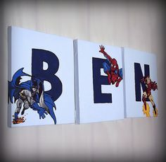 Can use anything that the child is into  http://www.uniquebedroom.com/wp-content/uploads/2011/07/Superheros-Name-Wall-Art.jpg