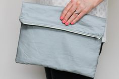 Fold over zipper clutch in slate grey (gray) with lemon yellow lining. $32.00, via Etsy.
