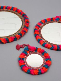 The Boho Tassel Mirror, a traditionally crafted Indian wall mirror decorated with a crochet frame, adorned with multi-colored fluffy tassel trim. These beautifully boho mirrors look fabulous in an ecl Bohemia Design, Handmade Mirrors, Diy Interior, Handicraft, Tassels, Tassles Diy, Creations, Diy Crafts, Crafty