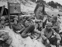 """Navy Aid Station."" (D-day) Corpsmen await business on a French invasion beach. 2nd Naval Beach Battallion, Utah Beach. World War 2. European Theater."