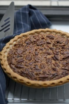 Nutty, crispy, and with a caramelized center, this quick and easy Pecan Pie Recipe is a perfect addition to any Thanksgiving table. Pecan Pie is a classic holiday dessert that doesn't include pumpkin or apples! The balance of nutty pecan flavor with the caramelized center is all held together by delicious buttery pie crust. Perfect for your Christmas dessert spread! #Christmas #pecanpie #pie #recipe #easy Easy Pie Recipes, Pecan Recipes, Best Dessert Recipes, Fun Desserts, Baking Recipes, Fall Recipes, Breakfast Recipes, Pumpkin Pecan Cobbler, Best Pecan Pie Recipe