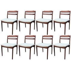 Stunning Set of Eight Danish Rosewood Dining Chairs | From a unique collection of antique and modern dining room chairs at https://www.1stdibs.com/furniture/seating/dining-room-chairs/