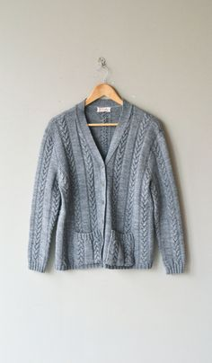 Vintage 1960s pewter gray wool cable knit cardigan with front pockets. --- M E A S U R E M E N T S ---  fits like: small/medium bust: up to 44 waist: