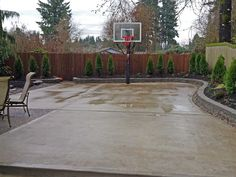 The concrete slab basketball court is great exercise for the whole family.