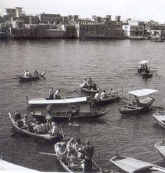 Dubai - in the 1970's.  I remember riding on these tiny boats to get across the Dubai creek.  It cost 25 fils - which is about 8 cents.  Dubai is split into two parts - Bur Dubai and Deira.  The creek divides the city/emirate.
