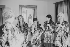 Bridesmaids emotional reaction to seeing the Bride dressed and ready for the first time for a festive Fall wedding at FEAST Roundhill in Washingtonville NY as photographed by Arius Photography.