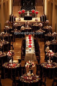 Romantic red floral wedding reception centerpiece; Featured Photographer: D. Jones Photography