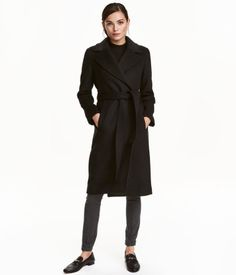 8dc74295 Coat in felted wool-blend fabric. Wide notched lapels, concealed side