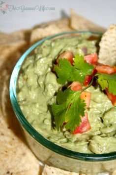Creamy Guacamole - The perfect dip recipe for chips! Easy guacamole with extra creaminess.  Great for a party or football games! From TheGraciousWife.com