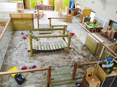I have never seen an indoor sandbox before. I like this idea because it does bring in outdoor elements but it also keeps it cleaner. Daycare Spaces, Childcare Rooms, Home Daycare, Kids Indoor Playground, Playground Design, Classroom Layout, Classroom Decor, Teen Bedroom Designs, Girls Bedroom
