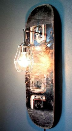 DIY Inspiration: Upcycled Skateboard Sconce (You can buy this, but it would be a simple DIY) Skateboard Decor, Skateboard Furniture, Skateboard Light, Furniture Making, Diy Furniture, Luminaire Vintage, Cage Light, Diy Inspiration, Industrial Lighting