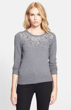 Captived by the sparkly sequins and rhinestones on this Milly sweater.