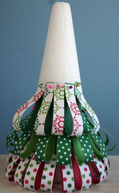 Paper strips pinned onto a styrofoam cone to make a Christmas tree.