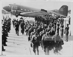 Liberated French prisoners of war returning to Paris following the Second World War, Le Bourget Airport, France, circa 1944-1945.