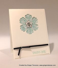 handmade thank you card ... negative space punched flower ... pretty patterned paper shows through ... like the small  knotted ribbon around the main panel ... sweet card! ...  Stampin' Up!