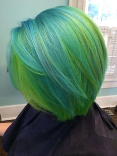 Green, blue, and yellow pravana neons hair color created by Hillary Sapp @lussohairstudio