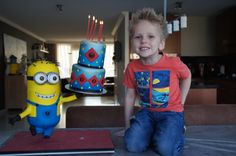 This cake I made for my sons birthday. A 3 d minion who holds a real cake, this was a chocolate brownie cake with raspberry cream My son loved him.