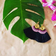 Brass swirl earrings feature woven cotton and a soft tassel trim. They hang 3 inches in length. Fair Trade, Made in Thailand Meet the Artisans Global Groove is a fair trade organization working with w
