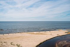 The Gulf of Riga  free high-resolution photo about Landscape Travel Locations baltic bay beach blue coast coastline day europe gulf horizon landscape Latvia nature ocean people riga sand saulkrasti sea sky summer sun sunny tourism travel vacation view water