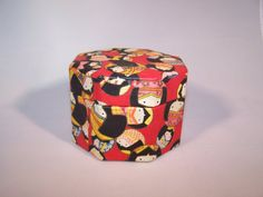This adorable box is expertly covered in beautifully decorated Japanese paper with round Kokeshi dolls painted in a variety of colors and poses. The interior of the octagonal box is black. Ironically, the sticker inside says made in China?