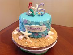 Little Mermaid cake. Fondant scales, disco dust. Candy shells. Modeling chocolate rock. Dragees.