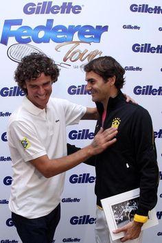 Former Brazillian tennis star Guga Kuerten and Roger Federer having some fun
