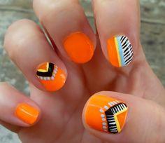orange + tribal nail art.
