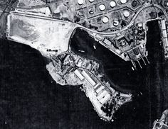 80-G-182875: Half-tone image of a photograph, Aerial of U.S. Naval Air Station, Pearl Harbor, Supply Base, Magazine Island (lower enter), Navy Yard Submarine Base (right center). Photograph received August 22, 1941. (8/25/2015).