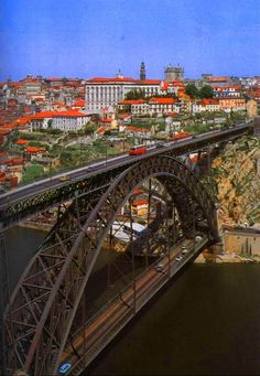 Oporto, Portugal, Bridge built by Eiffel, yes the same that built the Eiffel Tower in Paris Temple Construction Company 6346 Orchard Lake Rd. Spain And Portugal, Portugal Travel, Porto Portugal, Places To Travel, Places To See, Places Around The World, Around The Worlds, Famous Bridges, Portuguese Culture