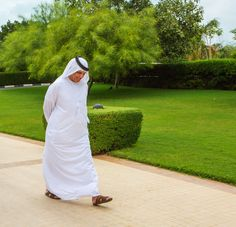 Sheikh Saud bin Saqr Al Qasimi, UAE Supreme Council Member and Ruler of Ras Al Khaimah strolling down a path.