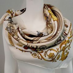 The ever so popular vintage Hermès scarf, La Promenade de Longchamps by Philippe Ledoux was first issued in 1965, depicting Parisians on the way to the races at Longchamps. A day at the races was quit