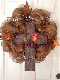 Beautiful Fall wreath made from brown striped Deco mesh accented with a large metal cross (17 x 12) adorned with acorns, and leaves! Wreath