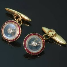 A pair of Art Deco diamond and ruby gold cufflinks with moonstones