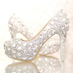 Fashionable and Glamorous wedding shoes with exclusive signature design  The shoes material is rhinestone and leather which is handmade on the upper, Lining material is PU leather. Its style of comfortable and perfect for special occasions and formal events. High Heels: We have various of high heels. Please refer the photo for details and send us message which one you are after.  Please choose a right size according to your measurements. If possible, you can send me your feet width and feet…