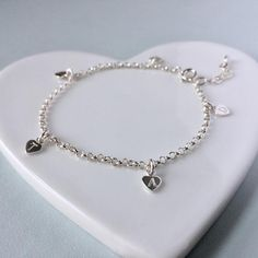 Sterling silver charm bracelet with five tiny hearts, engraved with your choice of initials, adjustable for a perfect fit Tiny Heart, Heart Charm, Initial Bracelet, Sterling Silver Charm Bracelet, Letter Charms, Personalized Jewelry, Heart Shapes, Initials, Pendant Necklace