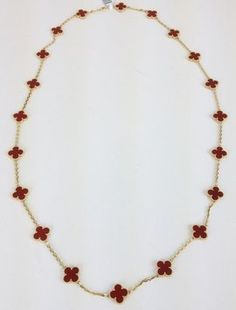 """VAN CLEEF & ARPELS ALHAMBRA 32"""" 20 CARNELIAN MOTIF 18KT YG NECKLACE. Get the lowest price on VAN CLEEF & ARPELS ALHAMBRA 32"""" 20 CARNELIAN MOTIF 18KT YG NECKLACE and other fabulous designer clothing and accessories! Shop Tradesy now"""