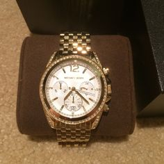NWT Michael Kors Watch NWT Authentic Muchael Kors watch. Gold with white face and diamonds. No scratches or missing diamonds. Original box and extra links come with watch. Woven band design. Style: MK-5835 Trades Michael Kors Accessories Watches