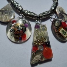 A resin necklace with a steampunk theme.