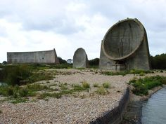 "Spectacular remnants of a dead-end technology, the three concrete ""listening ears"" at Denge near Dungeness in Kent are the best known of the various early warning acoustic mirrors built along Britain's coast. Dungeness Beach, Basalt Fiber, Romney Marsh, Kent Coast, Uk Images, Built Environment, Beautiful Architecture, Landscape Photos, Abandoned Places"
