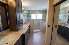 Dark cabinets are great for this earthy toned bathroom. www.choosechi.com