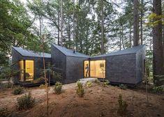 Prefabricated cabin clad in slate tiles.