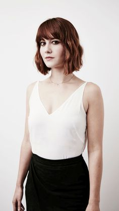 Mary Elizabeth Winstead in a white top and black skirt