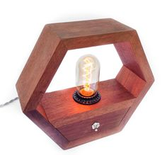 Light up your work or living space with this hexagonal hardwood edison lamp. South American Black Walnut is one of my favorite hardwoods to use for my home decor products. It is a stable wood, has exc